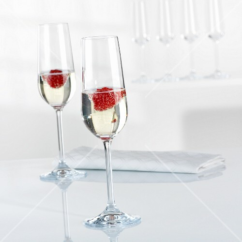 Champagne and raspberries in glasses