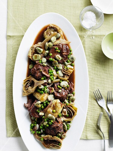 Lamb neck with artichokes, broad beans and peas