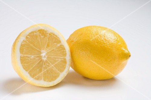 Half and Whole Lemon on White Background