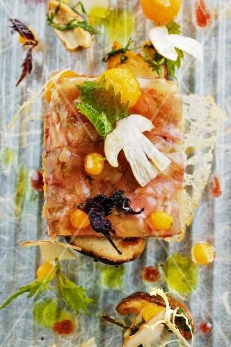 Calves brains in vinegar jelly with porcini mushrooms, melon and sesame leaves