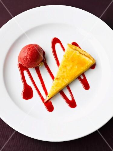 A slice of lemon tart with raspberry ice cream