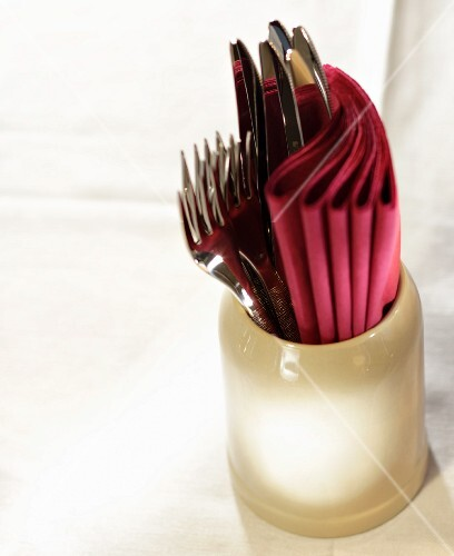 Cutlery and napkins in a jug
