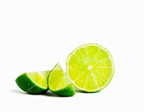 Half a lime and lime wedges
