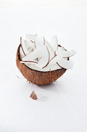 Half a coconut filled with coconut chips