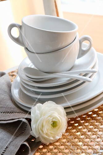 White coffee cups with saucers and side plates