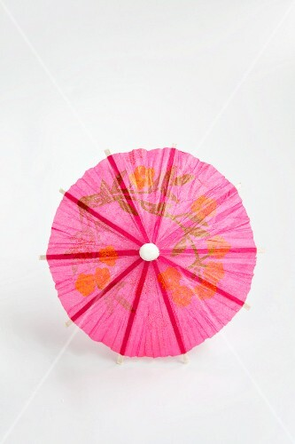 A pink cocktail umbrella