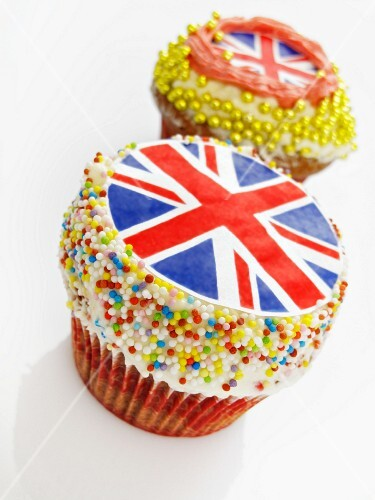 Two cupcakes decorated with Union Jacks