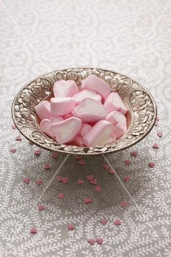Heart-shaped marshmallows in a silver dish