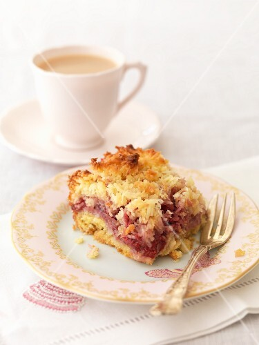 A slice of raspberry and coconut shortcake