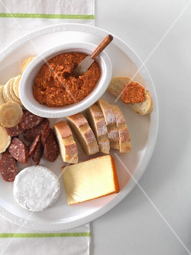 Red pepper spread, bread, sausage, cheese and crackers