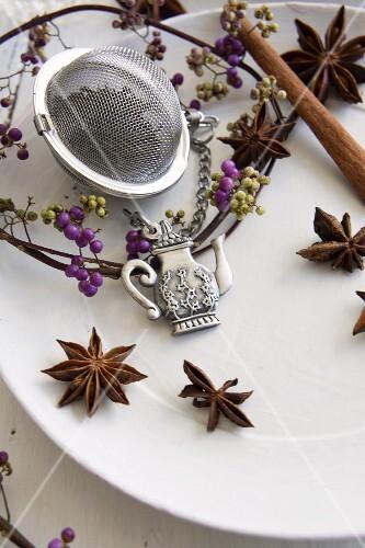 Homemade spiced tea with star anise and cinnamon in a tea egg