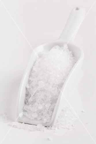 Coarse sea salt on a scoop