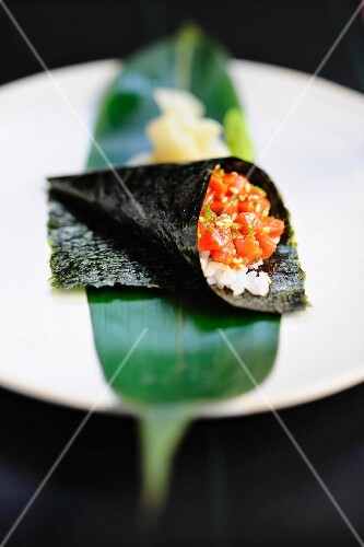 Temaki sushi with salmon and sesame seeds