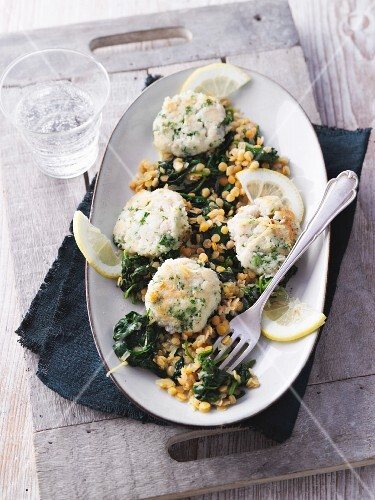 Mini fish bites on a lentil and spinach medley