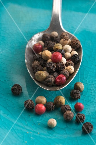 Colourful peppercorns on a spoon