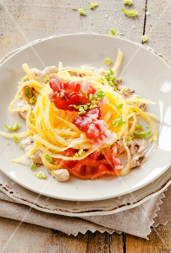 Turnip spaghetti with bacon and cheese sauce