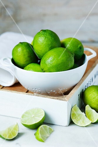 Limes in a colander