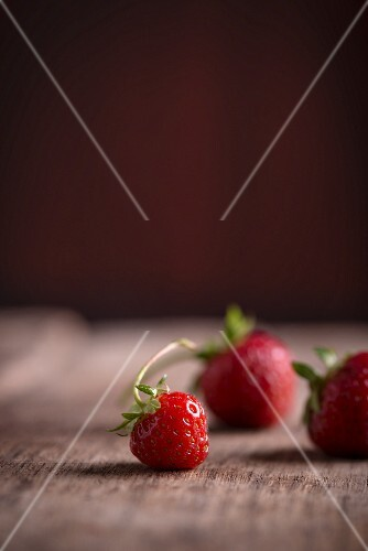 Strawberries on a wooden surface