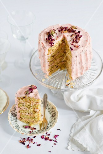 Rose and lemon layer cake, sliced, decorated with rose petals