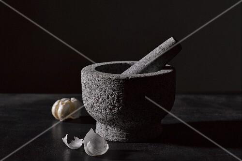 A mortar and garlic