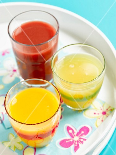 Three glasses of juice on a summer tray