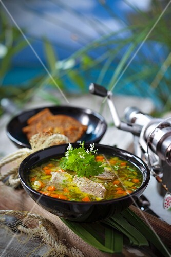 Freshwater fish soup with fresh herbs