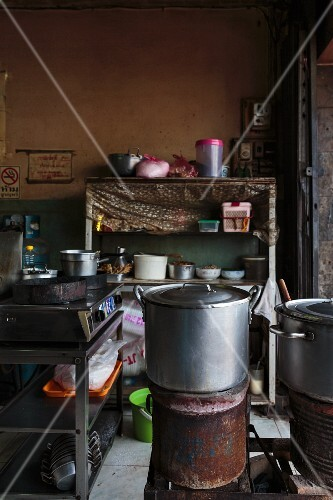 A dark cookshop at a market in Vientiane, Laos