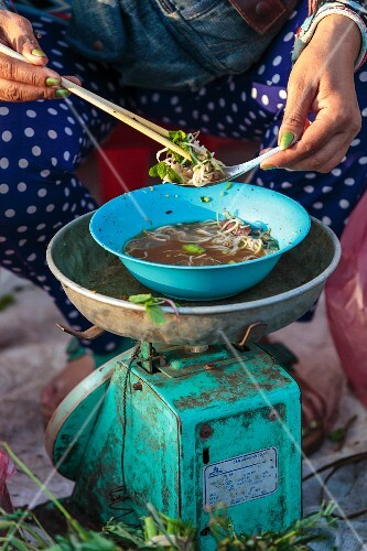 A market woman having breakfast, Vientiane, Laos