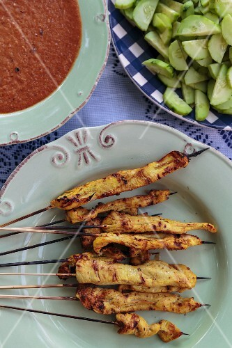 Grilled satay kebabs with peanut sauce and cucumber