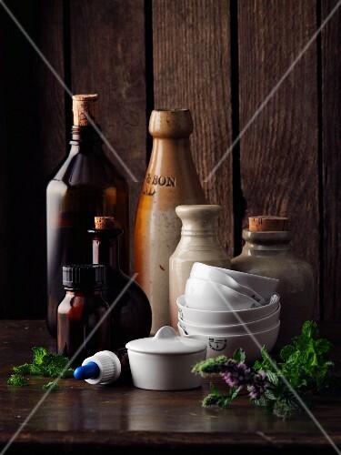 An arrangement of crucibles, glasses and bottles