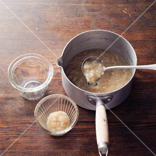 Baldmoney pear honey à la Hildegard von Bingen being transferred to glasses
