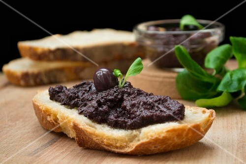 Olive paste on a slice of bread
