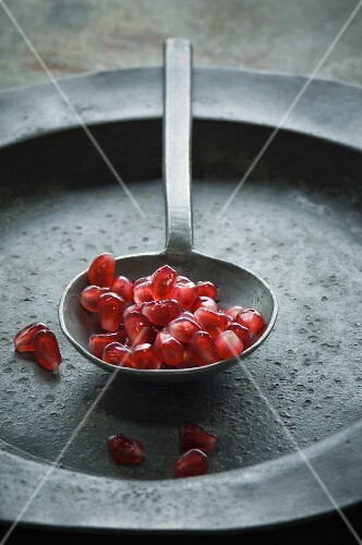 Pomegranate seed on a spoon (close-up)