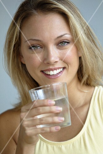 A young woman with a glass of water