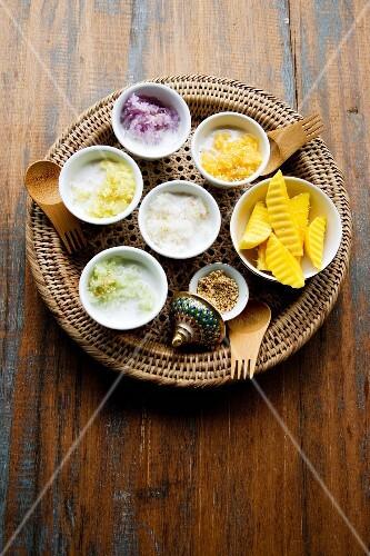 Khao Niau Mamuang (various types coloured sweet sticky rice with mango)