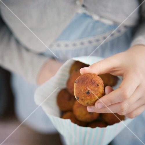 A child holding a lentil ball
