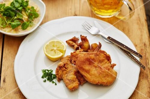 Fried pheasant with potato salad