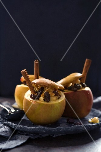 A baked apple with raisins and cinnamon