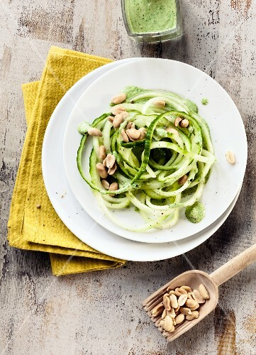 Cucumber vegetable spaghetti with a spinach and peanut sauce