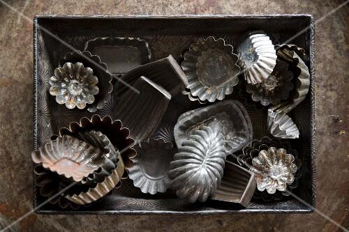 Various old metal baking tins