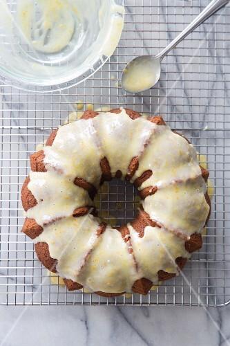 A spiced Bundt cake with lemon glaze on a wire rack