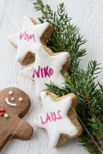 Cinnamon stars decorated with lettering written using food colouring pen