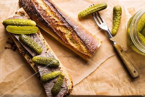 Baguette sandwich with pâté and cornichons