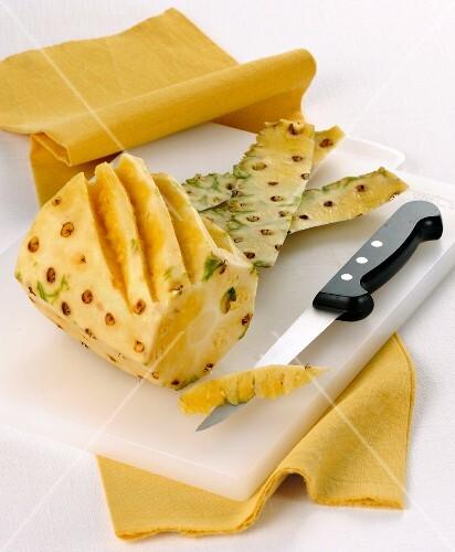 Pineapple being prepared