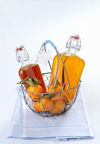 Orange and mandarin syrup in flip-top bottles