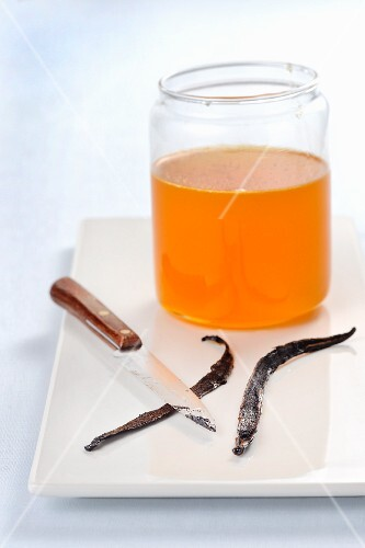 Vanilla seeds being scraped put for citrus fruit syrup