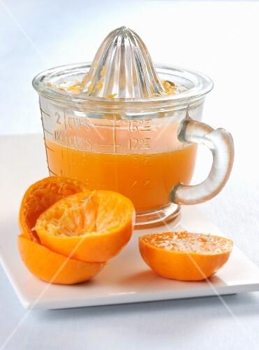 Freshly squeezed orange juice in a juicer