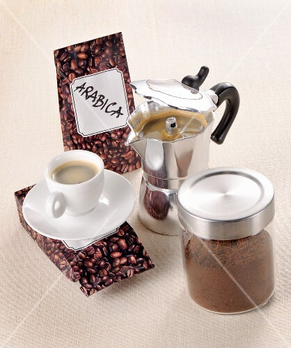 Arrangement of coffee beans, ground coffee and brewed coffee