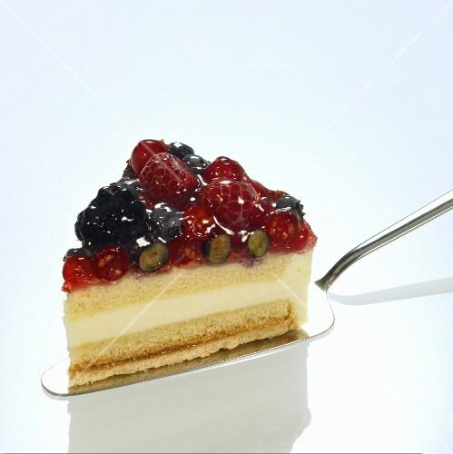 A slice of wild berry cake on a cake slice