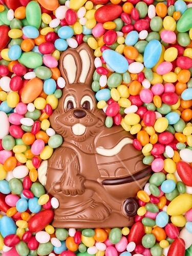 Colourful sugar eggs and a chocolate bunny